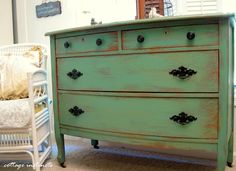 dry brush painting for cottage chic look instead of distressing and sanding off paint.  and knobs and pulls are refinished too !