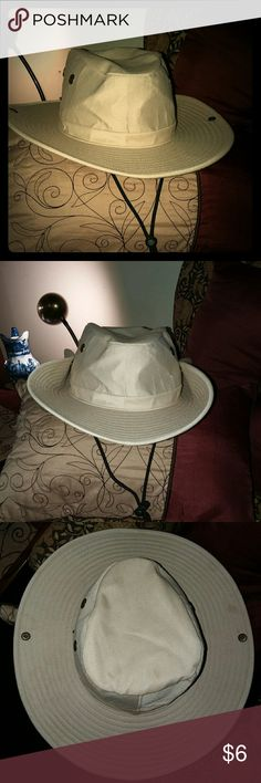 Mens hat This is a cool hat, worn once inside the house,lol. It still nerds breaking in. It has buttons on the sides too for a different shape,sturdy drawstring. Bundle with other items in my closet and get a great deal! Elite Sportswear Accessories Hats
