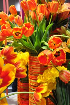 Extravagant explosion of orange tulips in a matching yarn wrapped glass vase. Where would you use a flower arrangement like this? Orange Flowers, My Flower, Fresh Flowers, Flower Power, Beautiful Flowers, Green And Orange, Orange Color, Orange Shades, Coral