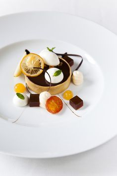 Nicole Franzen---I think this must be some sort of orange and chocolate ganache tart...in any case it's beautifully presented!