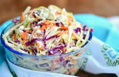 This tangy blue cheese slaw enhances everyone's favorite spicy chicken wing recipe.  This salad also enhances burgers, sandwiches and wraps.  Serve it at your next barbecue, picnic or tailgate party.