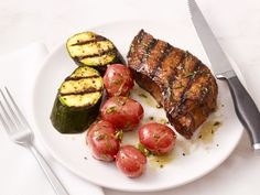 Grilled Steak and Zucchini : This easy weeknight dinner features grilled steak and zucchini plus herb oil and lemon juice dressed potatoes.