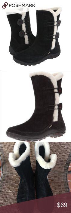 Merrell Waterproof Winter Boots Merrell Waterproof Black Winter Boots.  Good used condition.  Primaloft.  Round toe mid-shaft snow boots.  Spun wool collar trim. Merrell Shoes Winter & Rain Boots