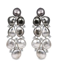Yoko London Mezze Luna earrings 18kt white gold necklace and earrings set with diamonds and South Sea Keshi pearls.