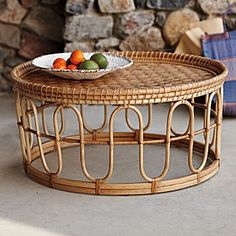 Banda Coffee Table: Inspired by a small offering table spotted in Southeast Asia. To create the criss-cross top and curvy details on the sides, artisans weave sustainable rattan vines by hand.