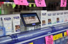 Nivea Shelf Kit. A modular shelf branding display with Interactive touch screen to find the right Nivea products for the consumer