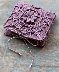 Beautiful Needle Book.  I don't think there is a tutorial but I know the linen will hold needles well and you could do any crochet pattern and use a sewing needle to sew it to the linen.