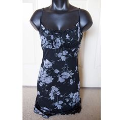 Black Blue Mini Dress Spaghetti Strap Slip Sexy Black mini-dress with blue grey flowers outlined in silver. Dress is cute elegant but pretty. Ruffles lightly at the bust and bottom. Dress is two layers with an inner slip and a chiffon cover. Stretchy fit so it would easily fit an XS-M. Brand: Byer Too! Size: M ✅✅Offers Considered!✅✅ Byer Dresses Mini