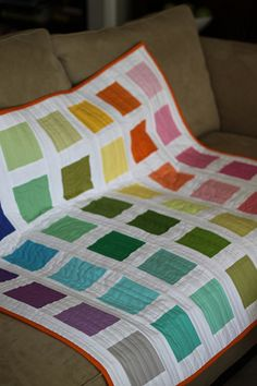 All you need is a Kona Solids bright palette charm pack and white fabric cut in 2.5 inch strips.