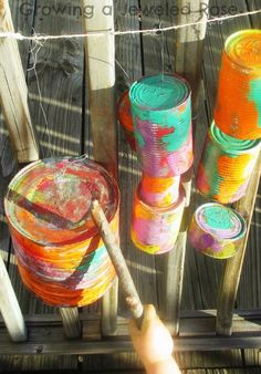 Make an outdoor music center using tin cans. Our preschool had a professional outdoor music station made for hundreds of dollars. This would be free. Just use old tin cans and some paint