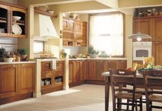Italian kitchen interior design means different things to different people. In recent years, Italian kitchens have become known for their sleek and innovative Italian Style Kitchens, Small Country Kitchens, Country Kitchen Designs, Beautiful Kitchen Designs, Beautiful Kitchens, Rustic Kitchen, Kitchen Decor, Maple Kitchen, Kitchen Country