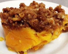 SWEET POTATO FLUFF 4 sweet potatoes, peeled, cubed, boiled, drained and mashed 1 cup sugar 2 eggs, beaten 1/2 cup butter, melted 1 tsp vanilla extract 1 cup sweetened flaked coconut 1 cup packed brown sugar 1/3 cup all-purpose flour 1 cup chopped pecans 1/3 cup butter, melted