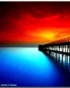 Orange sunset over blue water by the artist, God Creator.