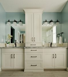 - Overview - Details - Why We Love It The Archie will instantly update your bathroom with on-trend and under-budget style. A win, win right? The strap and knob details and prismatic style glass shade