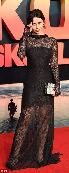 Lovely in lace: Billie JD Porter showed off her legs in a floor-skimming black lace number...