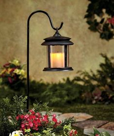 Flickering Solar Garden Candle Lantern with Stake by ABC Distributing. $22.20. Includes garden stake. No wires needed. Resembles flickering candle inside of lantern. Solar rechargeable LED Light. Charming Flickering Solar Lantern Stake is an attractive way to shed light on your outdoor space. The flickering candle looks like a real flame but is completely smoke free. Solar panel collects energy from the sun to power this classic-looking wireless lantern. The light au...