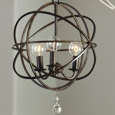 "Item: LC627  $229.00  An openwork sphere of hand crafted steel surrounds three upraised lights to illuminate your space. A single clear glass ball finial drops from the center for perfect punctuation. The look perfectly transitions into your nook, powder or entry.    Petite Orb Chandelier features:    6' hanging chain  5""Diam. ceiling canopy"