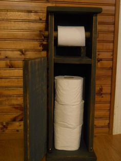 Primitive Farmhouse toilet paper holder. $44.99, via Etsy.