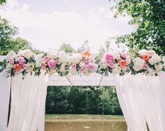peonies + roses on the ceremony arbor | Rachel May #wedding