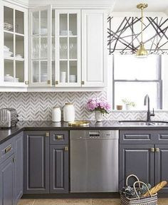 White and Grey Kitchen Cabinets with Gold Hardware.
