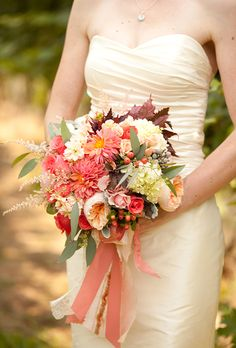 Love this one from Holly Chapple Flowers. Bride's bouquet of garden roses, hydrangeas, hibiscus foliage, dahlias, hypericum berries, silver brunias, dusty millers, stock, and seeded eucalyptus and spray roses. $325.00