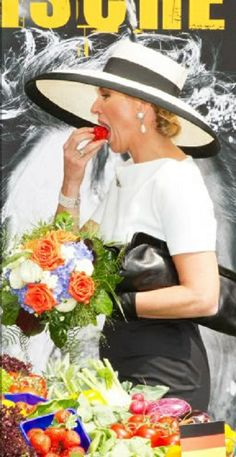 """Queen Maxima of The Netherlands couldn't resists to take a bite of the fresh strawberry during their visits to the company Mariko in Leer and attends the launch of the """"Frische ist Leben"""" initiative, 26.05.2014"""