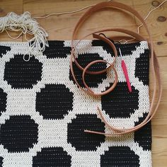 Berlin work studio & a dotted travelinbag made with @hoooked.zpagetti recycled yarns. There is a lot to do in the next 5 days before flying to Japan #howcoolisthat!! #makingofvirkkuribooks #mollamillscrochetterie #crochet #crocheteverywhere #goingplaces #seeingstuff #travelingirl #dots