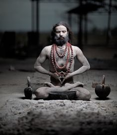 A Yogi master covered in human ashes practices the Meditation of the Dead.      photo: Martin Prihoda 500pix.com