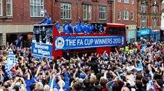 After their surprise 2013 FA Cup win against hot favourites Manchester City, Wigan take to the streets to share it with their fans .... Get your FREE DOWNLOAD of the SportsQuest app at www.sportsquestapp.com @SportsQuestApp
