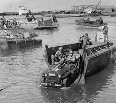 Jeep rolling off a landing boat during the landing operations of the U.S. task forces at Fedala harbor, Morocco. 1942.