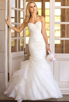Brides: Stella York. See more details from Stella York Trumpet wedding gown features asymmetrical organza pleats throughout its bodice and skirt. Choose from a corset closure or a zip up under crystal buttons.