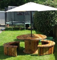 You can make round table and make the benches of circular shape. We have first made two disks from pallet woods and then placed one on the top of the table while trimmed the other disc into half and placed them on the benches.