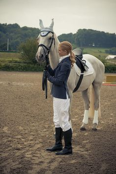 Keep hair away from your face. Wear it in a neat chignon or ponytail. You and your horse dresses horze outfit, even simple just white and dark blue. You both already look fantastic.