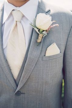 Ivory is a great colour for a groom to wear if it will match the brides dress. Seen here it compliments a light grey suit well.