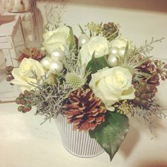 Our winter white tin. #flowergiftforchristmas #orderyours #roses #pinecones #baubles