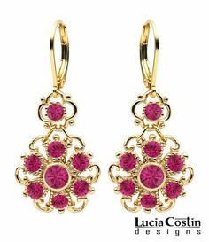 24K Yellow Gold Plated over .925 Sterling Silver Dangle Flower Earrings Designed by Lucia Costin with 4 Petal Lovely Flower, Twisted Lines, Dots and Fuchsia Swarovski Crystals Lucia Costin. $54.00. Create a delicate and romantic look. Unique and feminine, perfect to wear for special occasions and evenings. Lucia Costin dangle earrings. Beautifully designed with fuchsia Swarovski crystals. Produced delicately by hand, made in USA