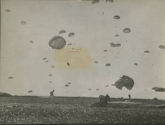 Paratroopers of the 101st Airborne Division land on their drop zone in Holland during Operation Market-Garden on September 17, 1944.