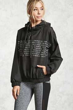 A woven athletic anorak featuring a front graphic of various affirmation words, a hooded top with drawstring neck, long sleeves with dropped shoulders and elasticized cuffs, a kangaroo pocket, and an elasticized waist.