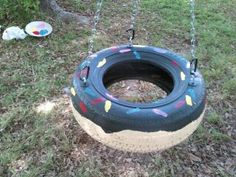 Old tire swing decorated into a donut definately doing this!!! Daughter loves doughnuts! I have 2 tires!