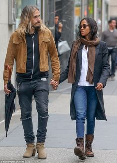 Loved up: Zoe Saldana and her husband Marco Perego were spotted hand-in-hand during a roma...