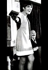 Miniskirt. Mary Quant (designer). In her Chelsea boutique girls rolled up the waistbands of their skirts to force the hemlines even higher. and decided to take things a step further. She debuted the mini in 1965.