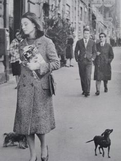 Audrey, sans make-up, enjoying a walk in Rome with her little furry friend(s?). (Candid) Date: c.1959.