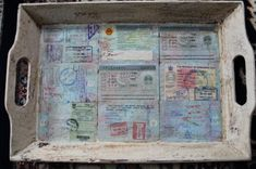 Decoupage the pages from an old passport onto a tray to save the memories.