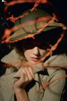 Lily Donaldson, featured in the March 2009 issue, wearing a D trench and a hat from Angels Fancy Dress. Photo By Tim Walker/Vogue