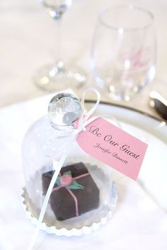 Use a mini glass bell jar for the perfect display of a tiny treat or favors