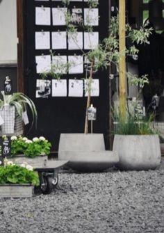 Concrete planters at a stylish garden centre