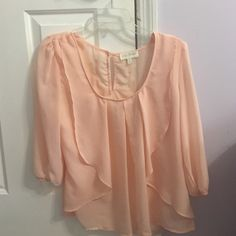 Peach blouse with cream lace Peach blouse with ruffles in front. On the back there is cream lace detailing and a button to secure the top. My Michelle Tops Blouses