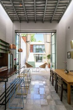Dining room with huge glass doors to the backyard located in Merida Mexico [736  1104]