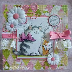 I love the dimensionality this card has. The flowers and the lace ruffles are such cute touches too!