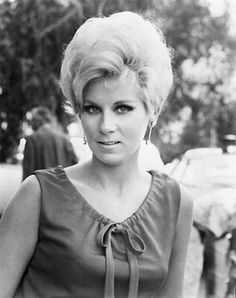 Grace Lee Whitney. Her own hair was beautiful, let alone that gorgeous basket-weave wig she wore when she was a semi-regular on the original Star Trek series.